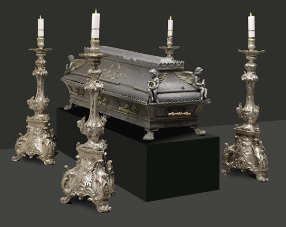 Tin coffin, gilded, 19th century, surrounded by silver candleholders dated to the Middle of 18th century St. Stanislaus Church in Waplewo, Archcathedral Basilica of the Assumption of the Blessed Virgin Mary in Frombork